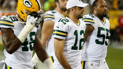 Green Bay Packers players leave the field during a lightning delay in the first half of an NFL football game against the Chicago Bears Thursday, Sept. 28, 2017, in Green Bay, Wis. (AP Photo/Matt Ludtke)