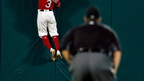 Umpire Rob Drake, front, watches as Texas Rangers center fielder Delino DeShields (3) is unable to reach a solo home run hit by Oakland Athletics' Matt Chapman in the fifth inning of a baseball game, Thursday, Sept. 28, 2017, in Arlington, Texas. (AP Photo/Tony Gutierrez)