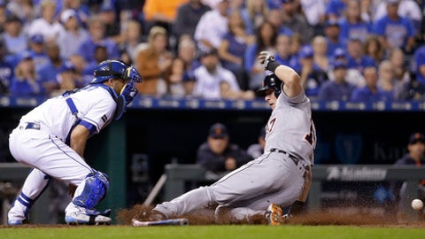 Detroit Tigers' Andrew Romine, right, beats the tag by Kansas City Royals catcher Drew Butera to score on a single by JaCoby Jones during the fifth inning of a baseball game Thursday, Sept. 28, 2017, in Kansas City, Mo. (AP Photo/Charlie Riedel)