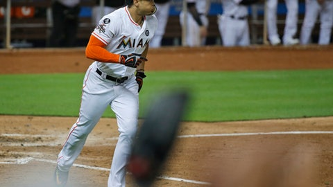 Fans stand and cheer as Miami Marlins' Giancarlo Stanton heads to first base after hitting a home run during the eighth inning of a baseball game against the Atlanta Braves, Thursday, Sept. 28, 2017, in Miami. (AP Photo/Wilfredo Lee)