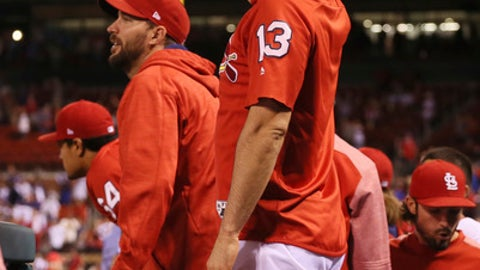 St. Louis Cardinals' Matt Carpenter, foreground, and Adam Wainwright, second from left, react after Chicago Cubs center fielder Leonys Martin robbed a potential game-tying home run from Paul DeJong in the bottom of the 11th inning to preserve a one-run lead during a baseball game Thursday, Sept. 28, 2017, at Busch Stadium in St. Louis. The loss officially eliminated the Cardinals from playoff contention. (Chris Lee/St. Louis Post-Dispatch via AP)