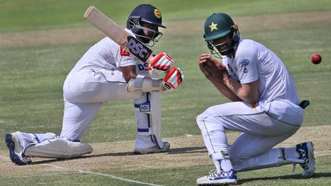 Sri Lanka's batsman Niroshan Dickwella plays a shot during their second day of the first test cricket match against Pakistan in Abu Dhabi, United Arab Emirates, Friday, Sept. 29, 2017. (AP Photo/Kamran Jebreili)