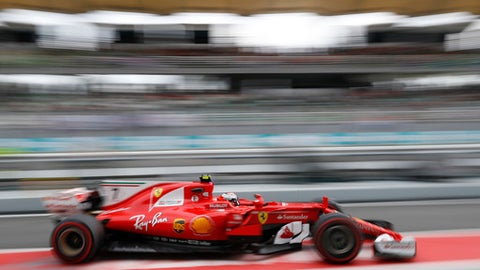 Ferrari driver Kimi Raikkonen of Finland drives in pit lane during during the second practice at the Sepang International Circuit for the first practice session for the Malaysian Formula One Grand Prix in Sepang, Malaysia, Friday, Sept. 29, 2017. (AP Photo/Vincent Thian)