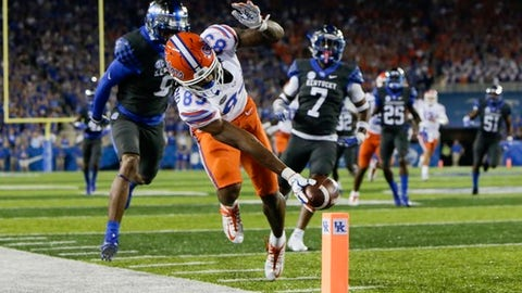 FILE - In this Sept. 23, 2017 file photo, Florida wide receiver Tyrie Cleveland reaches for the goal line in front of Kentucky cornerback Derrick Baity, left, and safety Mike Edwards to score a touchdown during the first half of an NCAA college football game  in Lexington, Ky.   Vanderbilt and Florida have played tight games the last two years. Considering Florida's most recent performances, no one would be surprised to see another one Saturday, Sept. 30. (AP Photo/David Stephenson)