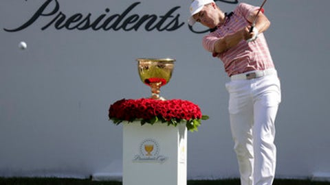 Jordan Spieth hits from the first tee during the four-ball golf matches on the second day of the Presidents Cup at Liberty National Golf Club in Jersey City, N.J., Friday, Sept. 29, 2017. (AP Photo/Julio Cortez)