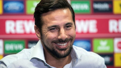 The new striker of German Bundesliga soccer club 1. FC Cologne Claudio Pizarro smiles during a news conference in Cologne, Germany, Friday, Sept. 29, 2017. Cologne has signed veteran Peru striker Pizarro in a bid to boost its attacking threat. (Federico Gambarini/dpa via AP)