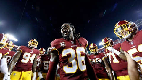FILE - In this Sunday, Sept. 24, 2017, file photo, Washington Redskins free safety D.J. Swearinger (36) motivates his team in the huddle before an NFL football game against the Oakland Raiders in Landover, Md. What's the difference in the Redskins' defense that was ranked 28th in the NFL the past two seasons? New players. Better players. Safety D.J. Swearinger and linebacker Zach Brown are among the newcomers reshaping the Redskins' defense far earlier than expected.(AP Photo/Alex Brandon, File)