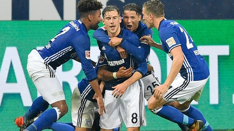 Schalke's Leon Goretzka is celebrated by teammates after scoring the opening goal during the German Bundesliga soccer match between FC Schalke 04 and Bayer Leverkusen at the Arena in Gelsenkirchen, Germany, Friday, Sept. 29, 2017. (AP Photo/Martin Meissner)