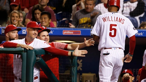 Philadelphia Phillies' Nick Williams (5) is congratulated after scoring on a balk by New York Mets starting pitcher Matt Harvey in the fourth inning of a baseball game, Friday, Sept. 29, 2017, in Philadelphia. (AP Photo/Laurence Kesterson)