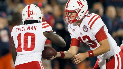 Nebraska quarterback Tanner Lee (13) hands the ball off to wide receiver JD Spielman during the first half of an NCAA college football game against Illinois on Friday, Sept. 29, 2017, in Champaign, Ill. (AP Photo/Stephen Haas)