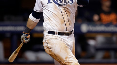 Tampa Bay Rays' Logan Morrison watches his home run off Baltimore Orioles relief pitcher Chris Tillman during the seventh inning of a baseball game Friday, Sept. 29, 2017, in St. Petersburg, Fla. (AP Photo/Chris O'Meara)