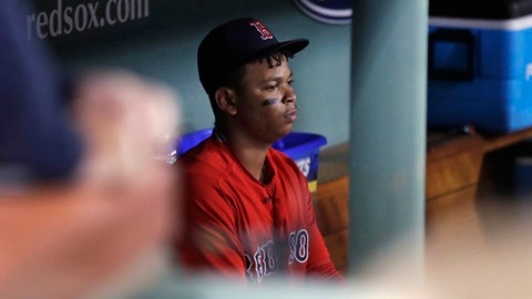 Boston Red Sox's Rafael Devers sits in the dugout after grounding out to end a baseball game against the Houston Astros at Fenway Park in Boston, Friday, Sept. 29, 2017. The Astros won 3-2. (AP Photo/Charles Krupa)