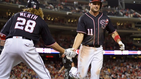 Washington Nationals' Ryan Zimmerman (1) celebrates his home run with Jayson Werth during the eighth inning of a baseball game against the Pittsburgh Pirates, Friday, Sept. 29, 2017, in Washington. The Nationals won 6-1. (AP Photo/Nick Wass)