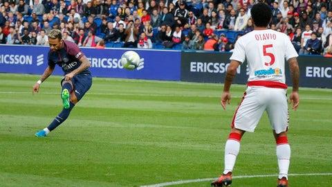 PSG's Neymar scores a free kick during a French League One soccer match Paris-Saint-Germain against Bordeaux at Parc des Princes stadium in Paris, France, Saturday, Sept. 30, 2017. (AP Photo/Michel Euler)
