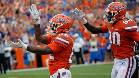 Florida running back Lamical Perine, left, celebrates his touchdown run against Vanderbilt with teammate C'yontai Lewis (80) during the first half of an NCAA college football game, Saturday, Sept. 30, 2017, in Gainesville, Fla. (AP Photo/John Raoux)