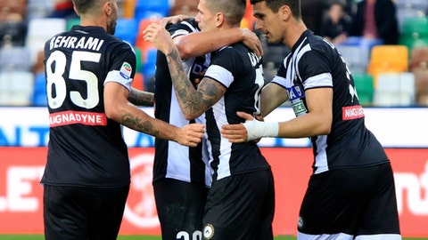 Udinese's Rodrigo De Paul, 2nd from right, celebrates with his teammates after scoring during the Serie A soccer match between Udinese and Sampdoria at the Friuli stadium in Udine, Italy, Saturday, Sept. 30, 2017. (Alberto Lancia/ANSA via AP)