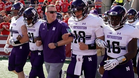 Northwestern head coach Pat Fitzgerald leads his team on the field before an NCAA college football game against Wisconsin Saturday, Sept. 30, 2017, in Madison, Wis. (AP Photo/Morry Gash)