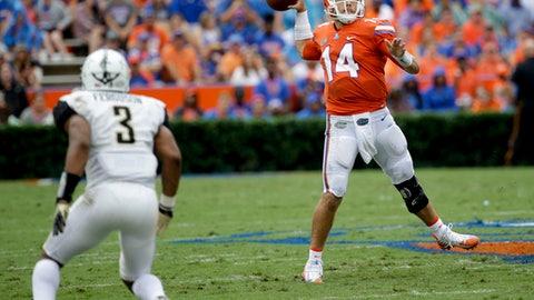 Florida quarterback Luke Del Rio (14) throws a pass as he is pressured by Vanderbilt cornerback Taurean Ferguson (3) during the first half of an NCAA college football game, Saturday, Sept. 30, 2017, in Gainesville, Fla. (AP Photo/John Raoux)