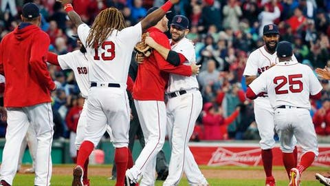 The Boston Red Sox celebrate after defeating the Houston Astros 6-3 in a baseball game and clinching the American League East Division championship  in Boston, Saturday, Sept. 30, 2017. (AP Photo/Michael Dwyer)