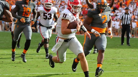 Georgia quarterback Jake Fromm reaches the end zone a touchdown runs during the first half of an NCAA college football game against Tennessee on Saturday, Sept. 30, 2017, in Knoxville, Tenn. (Curtis Compton/Atlanta Journal-Constitution via AP)