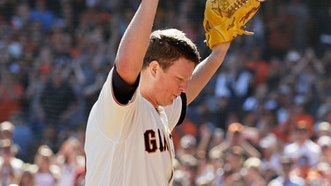 San Francisco Giants starting pitcher Matt Cain raises his arms as he walks to the dugout after pitching in the fifth inning of a baseball game against the San Diego Padres, Saturday, Sept. 30, 2017, in San Francisco. Cain made his final start after announcing his retirement. (AP Photo/Eric Risberg)