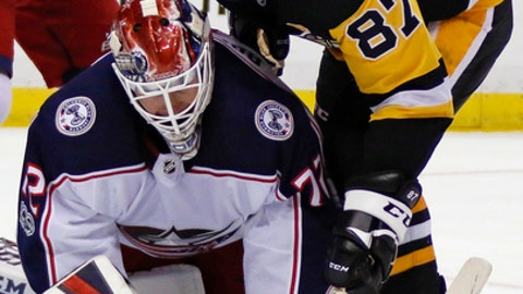 Columbus Blue Jackets goalie Sergei Bobrovsky (72) covers the puck in front of Pittsburgh Penguins' Sidney Crosby (87) in the second period of a NHL preseason hockey game in Pittsburgh, Saturday, Sept. 30, 2017. (AP Photo/Gene J. Puskar)