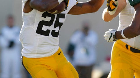 Iowa's Akrum Wadley (25) rushes against Michigan State's Andrew Dowell during the second quarter of an NCAA college football game, Saturday, Sept. 30, 2017, in East Lansing, Mich. (AP Photo/Al Goldis)