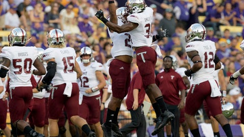Troy linebacker A.J. Smiley (31) celebrates a defensive play on fourth down making LSU turnover on downs in the first half of an NCAA college football game in Baton Rouge, La., Saturday, Sept. 30, 2017. (AP Photo/Matthew Hinton)