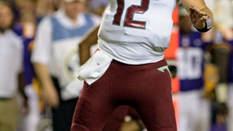 Troy quarterback Brandon Silvers (12) throws against LSU in the first half of an NCAA college football game in Baton Rouge, La., Saturday, Sept. 30, 2017. (AP Photo/Matthew Hinton)