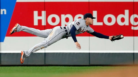 Detroit Tigers center fielder JaCoby Jones makes a diving try but can't pull in the ball for a hit by Minnesota Twins' Ehire Adrianza in the seventh inning of a baseball game Saturday, Sept. 30, 2017, in Minneapolis. (AP Photo/Jim Mone)