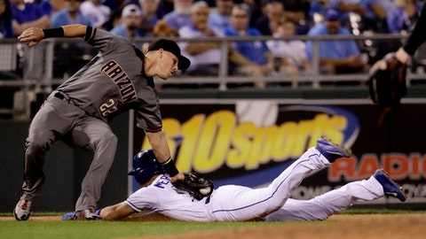 Kansas City Royals' Whit Merrifield, right, is caught stealing third by Arizona Diamondbacks third baseman Jake Lamb (22) during the sixth inning of a baseball game Saturday, Sept. 30, 2017, in Kansas City, Mo. (AP Photo/Charlie Riedel)