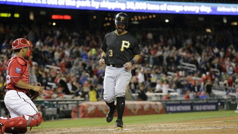 Pittsburgh Pirates' Sean Rodriguez scores on a Max Moroff triple during the ninth inning of a baseball game against the Washington Nationals, Saturday, Sept. 30, 2017, in Washington. The Pittsburgh Pirates won the game 4-1. (AP Photo/Mark Tenally)