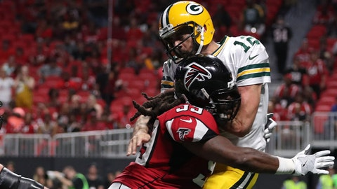 Sep 17, 2017; Atlanta, GA, USA; Atlanta Falcons defensive end Adrian Clayborn (99) hits Green Bay Packers quarterback Aaron Rodgers (12) after a pass attempt in the fourth quarter of their game at Mercedes-Benz Stadium. Mandatory Credit: Jason Getz-USA TODAY Sports