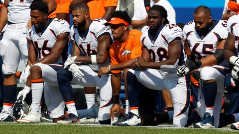 Sep 24, 2017; Orchard Park, NY, USA; Denver Bronco players kneel in protest during the National Anthem before a game against the Buffalo Bills at New Era Field. Mandatory Credit: Timothy T. Ludwig-USA TODAY Sports