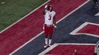 Utah's Troy Williams scores on a 1-yd touchdown run