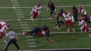 Arizona's J.J. Taylor scores on a 7-yd touchdown run