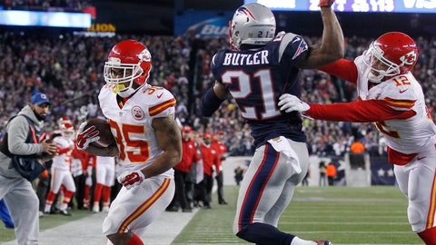 Jan 16, 2016; Foxborough, MA, USA; Kansas City Chiefs running back Charcandrick West (35) scores a touchdown past New England Patriots cornerback Malcolm Butler (21) during the second half in the AFC Divisional round playoff game at Gillette Stadium. The Patriots won 20-27. Mandatory Credit: Stew Milne-USA TODAY Sports