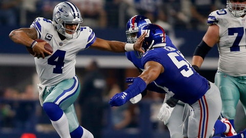 Sep 10, 2017; Arlington, TX, USA; Dallas Cowboys quarterback Dak Prescott (4) breaks a tackled by New York Giants defensive end Romeo Okwara (78) and defensive end Olivier Vernon (54) in the second quarter at AT&T Stadium. Mandatory Credit: Tim Heitman-USA TODAY Sports