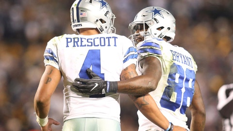 Nov 13, 2016; Pittsburgh, PA, USA;  Dallas Cowboys quarterback Dak Prescott (4) and wide receiver Dez Bryant (88) celebrate after a touchdown against the Pittsburgh Steelers during the fourth quarter at Heinz Field. Dallas won 35-30. Mandatory Credit: Charles LeClaire-USA TODAY Sports
