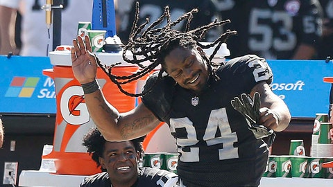 Sep 17, 2017; Oakland, CA, USA; Oakland Raiders running back Marshawn Lynch (24) dances on the sideline during a break in the action against the New York Jets in the fourth quarter at Oakland Coliseum. Mandatory Credit: Cary Edmondson-USA TODAY Sports