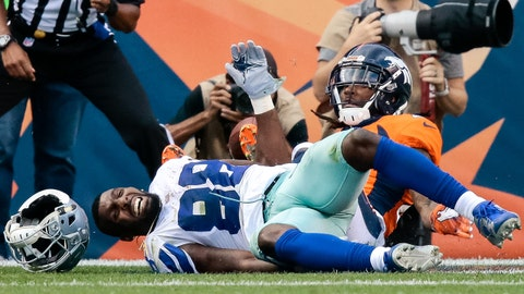 Sep 17, 2017; Denver, CO, USA; Dallas Cowboys wide receiver Dez Bryant (88) loses his helmet on a play with Denver Broncos cornerback Bradley Roby (29) in the fourth quarter at Sports Authority Field at Mile High. Mandatory Credit: Isaiah J. Downing-USA TODAY Sports