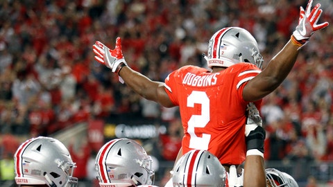 Ohio State running back J.K. Dobbins, top, celebrates his touchdown against Oklahoma during the second half of an NCAA college football game Saturday, Sept. 9, 2017, in Columbus, Ohio. (AP Photo/Paul Vernon)