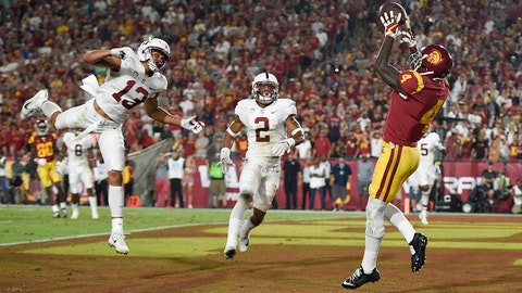 Sep 9, 2017; Los Angeles, CA, USA; Southern California Trojans wide receiver Steven Mitchell Jr. (4) catches a touchdown pass against the Stanford Cardinal during the fourth quarter at Los Angeles Memorial Coliseum. Mandatory Credit: Kelvin Kuo-USA TODAY Sports