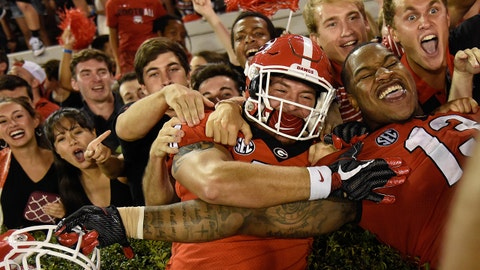 Sep 23, 2017; Athens, GA, USA; Georgia Bulldogs Jacob Gross (48) left and defensive end Jonathan Ledbetter (13) celebrate with fans after defeating the Mississippi State Bulldogs at Sanford Stadium. Mandatory Credit: Dale Zanine-USA TODAY Sports