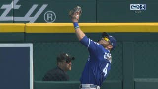 Alex Gordon times his leap and elevates at the wall to rob Mikie Mahtook of a 3-run blast