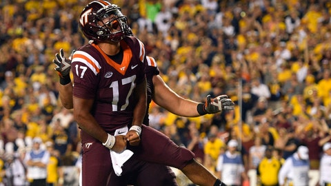 Sep 3, 2017; Landover, MD, USA; Virginia Tech Hokies quarterback Josh Jackson (17) celebrates after scoring a touchdown against the West Virginia Mountaineers during the second quarter at FedEx Field. Mandatory Credit: Derik Hamilton-USA TODAY Sports