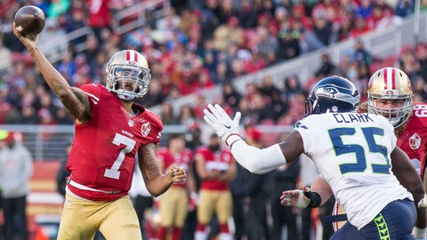 Jan 1, 2017; Santa Clara, CA, USA; San Francisco 49ers quarterback Colin Kaepernick (7) passes the football against Seattle Seahawks defensive end Frank Clark (55) during the fourth quarter at Levis Stadium Seahawks defeated the 49ers 25-23. Mandatory Credit: Neville E. Guard-USA TODAY Sports