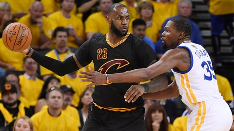 Jun 12, 2017; Oakland, CA, USA; Cleveland Cavaliers forward LeBron James (23) is defended by Golden State Warriors forward Kevin Durant (35) during the third quarter in game five of the 2017 NBA Finals at Oracle Arena. Mandatory Credit: Kyle Terada-USA TODAY Sports
