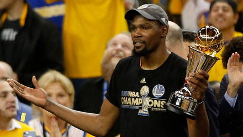 Jun 12, 2017; Oakland, CA, USA; Golden State Warriors forward Kevin Durant (35) celebrates with the series MVP award after defeating the Cleveland Cavaliers in game five of the 2017 NBA Finals at Oracle Arena. Mandatory Credit: Cary Edmondson-USA TODAY Sports