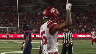 Utah's Tyler Huntley connects with an 8-yd touchdown pass to Samson Nacua